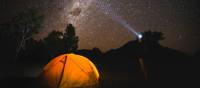 The night sky filled with bright stars over Australia's only Dark Sky Park in the Warrumbungles.   Destination NSW