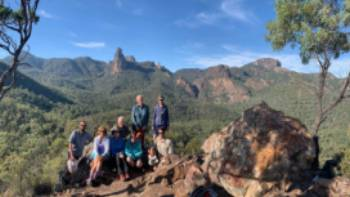 Enjoying the magical Warrumbungles from Macha Tor, with the Breadknife and the Belougery Spire in the background.
